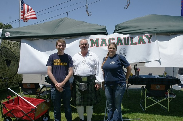 Jim McAuley flanked by MacAulay visitors to the Clan tent